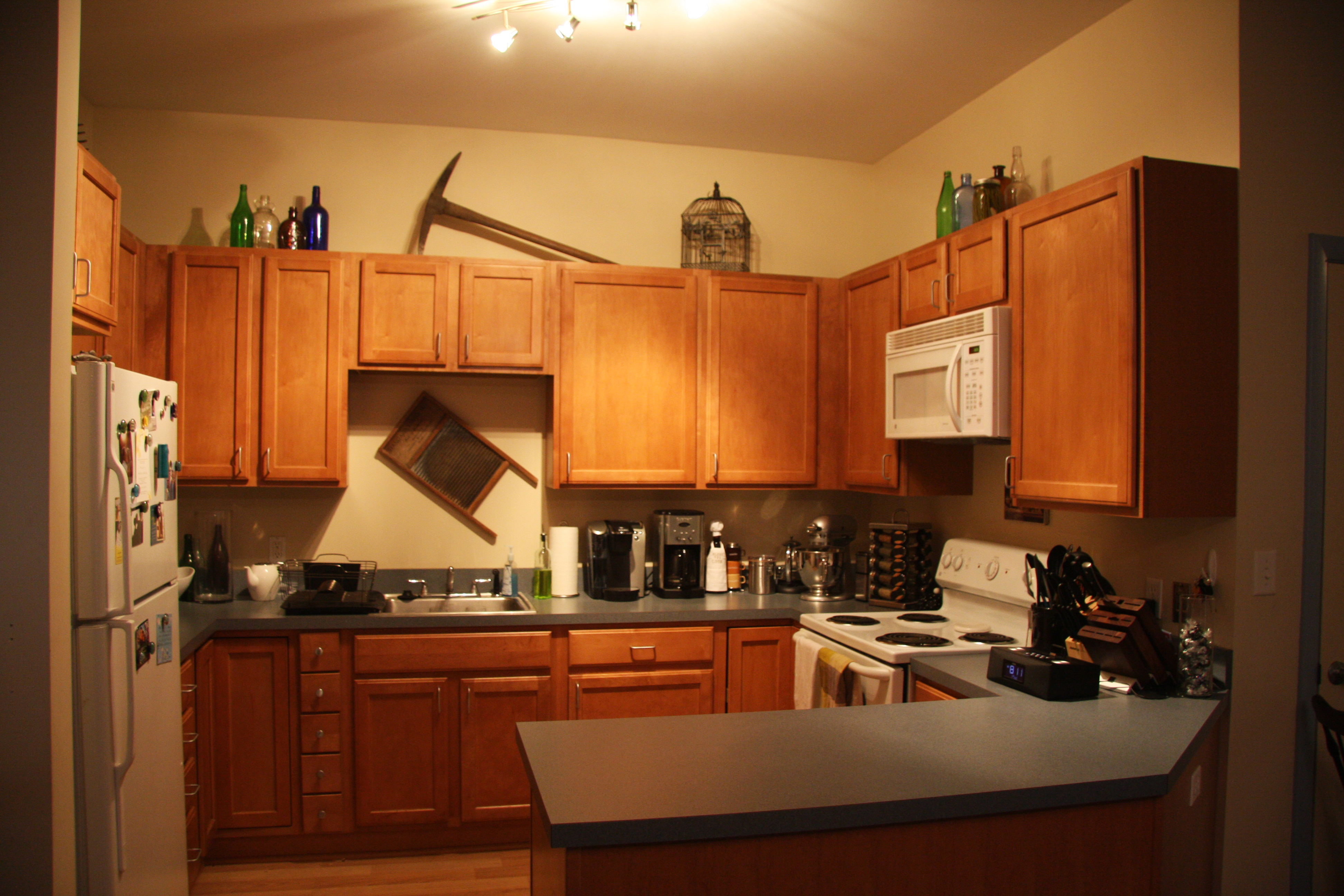 elegant what to put on top of kitchen cabinets pictures - taste
